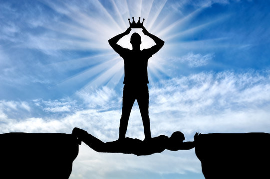 Selfish man puts his crown on his head, he is on the man in the form of a bridge over the abyss