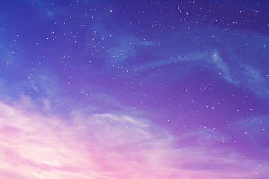View on a evening purple sky with cirrus clouds and stars (background, abstract)