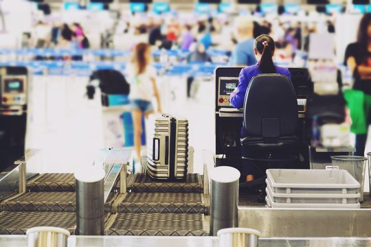 blurred airport check in desk counter gate with weighting luggage belt