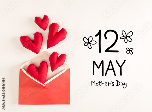 Mother's Day message with red heart cushions coming out of an envelope