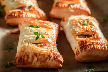 Tasty sausage in puff pastry as a snack for breakfast