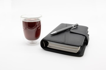 filofax and coffee, isolated on white background