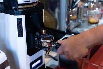 Coffe grinder in cafe.