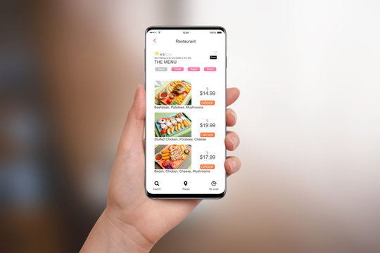 Girl ordering food with app on her smartphone, on blurred background