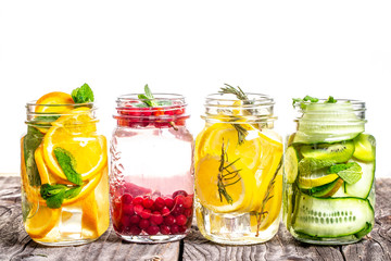 Variety of infused detox water isolated on white. diet healthy eating and weight loss. healthy lifestyle concept, overhead view