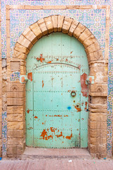 Fancy Green Door in Essaouira Morocco Surrounded by Colorful Tiles
