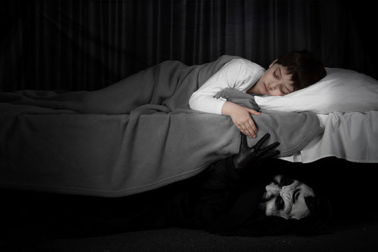 Little boy and monster under the bed. Bad dreams concept.