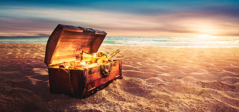 treasure chest at the beach by sunset