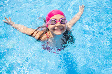 girl swim in  pool