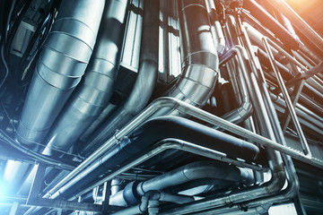 Fototapeta Industrial steel pipes or tubes of air ventilation system as abstract industry equipment background obraz