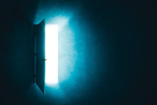open door in a dark room