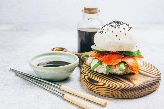 Homemade asian style gluten free sushi salmon burger.