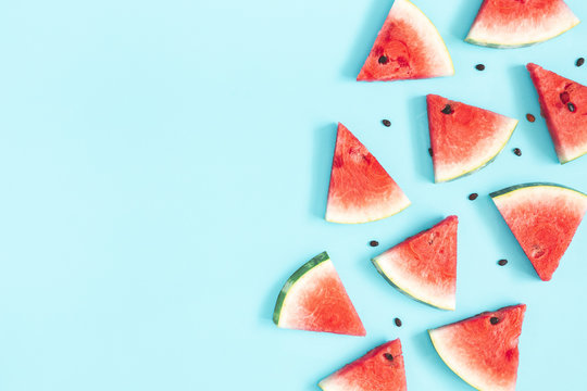 Watermelon pattern. Red watermelon on blue background. Summer concept. Flat lay, top view, copy space