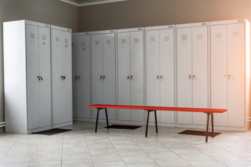 dressing room with metal drawers and benches