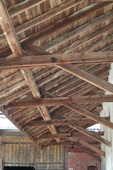 woodwork of projecting roof of an old farmhouse