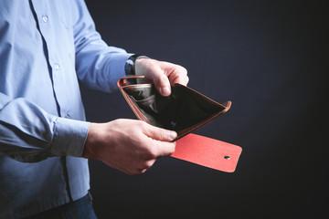 Man holding empty wallet. Crisis