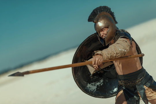Male athlete in the armor of an ancient warrior