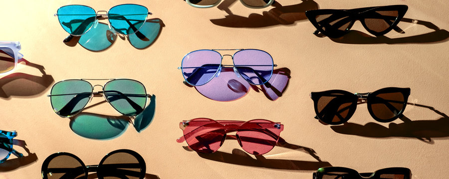 Variety of sunglasses over colorful background