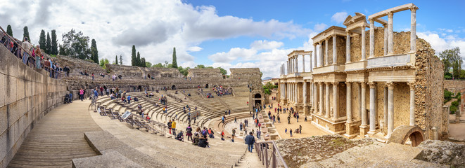 Merida, Spain. April 2019: Tourist crowd in the Antique Roman Theatre in Merida. Panorama image. The Archaeological Ensemble of Merida is declared a UNESCO World Heritage Site Ref 664