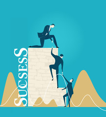 Business people climbing on the wall of success