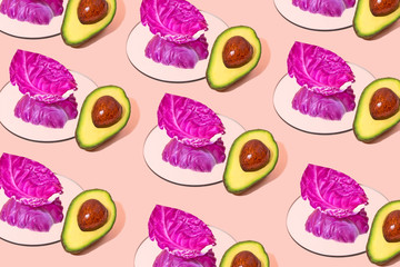 Fresh avocado and cabbage pattern on pink background flat lay