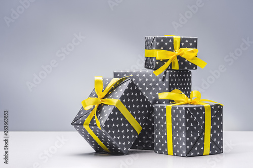 Collection Of Boxes With Gifts For Men In Elegant Paper With Yellow