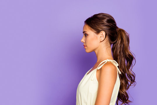 Close-up profile side view portrait of nice-looking well-groomed attractive stunning lovable fascinating magnificent winsome chic content wavy-haired girl isolated over violet pastel background