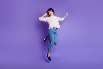 Wall Mural - Full length body size view photo charming nice millennial youngster have holidays  rejoice candid content isolated pullover denim blue sneakers raise hands arms vibrant background