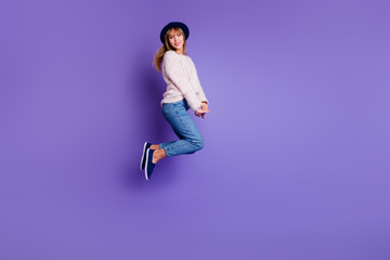 Wall Mural - Full length body size view photo charming pretty attractive teen teenager have holidays  rejoice candid content isolated sweater modern denim blue sneakers colorful background