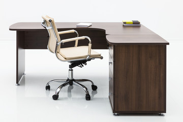 wood table and leather armchair
