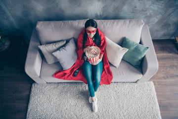 High angle top above photo beautiful she her superpower lady costume hold popcorn container watch premiere new long wait comics picture wear red eye mask mantle sit sofa couch divan house indoors