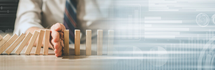 Concept of business control by stopping domino effect. panoramic banner