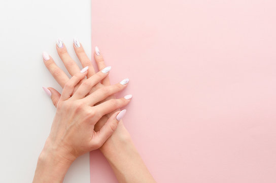 Top view woman's hands manicure with nail painting work. Drawing on nails banner concept for a beauty salon with copy space