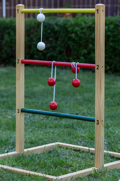 Game of ladder golf set up outdoors in a garden