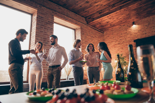 Company of six nice trendy attractive pretty elegant cheerful glad positive caucasian guys ladies pairs pal having fun luncheon brunch best tradition table buffet snack industrial loft interior room