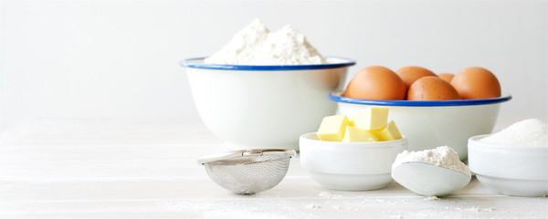 Ingredients for making dough, dessert on white wooden table. Flour, butter, sugar, eggs ingredients Papier Peint