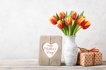 Mother's Day greeting card with fresh tulips and gift box