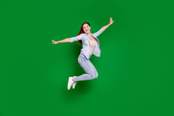 Wall Mural - Full length body size view portrait of her she nice-looking attractive lovely slim fit thin cheerful cheery glad girl having fun time isolated over bright vivid shine green background