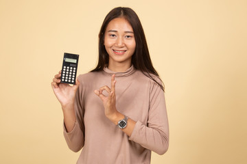 Asian woman show OK with calculator.