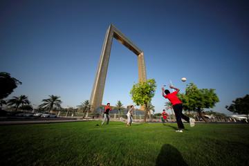 Children play soccer in a park near Dubai Frame in Dubai