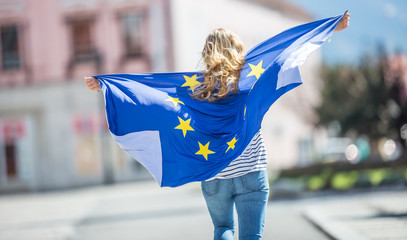 Attractive happy young girl with the flag of the European Union