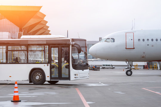 Bus to transport passengers to the aircraft, and the airplane. Nose to nose.
