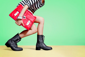 woman with boots shoes and handbag purse. fashion image