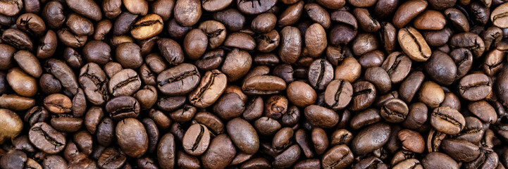 Coffee grains. Background of roasted coffee beans brown. layout. Flat lay.