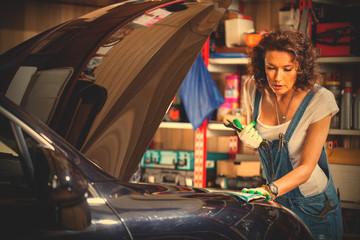 mechanic woman working on a car