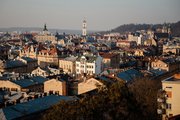 Rooftops of the old city Lviv in Ukraine during the sunset. Beautiful scenic landmark top view of the old town.