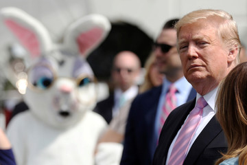 A person in an Easter Bunny costume looks on as U.S. President Trump attends the 2019 White House Easter Egg Roll in Washington