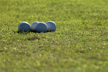 Close up picture of lacrosse balls on the green field.