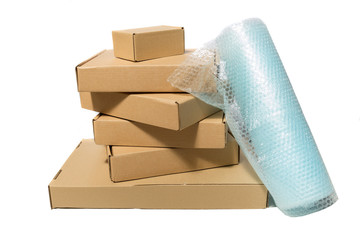 pile of various size boxes and bubble packing material