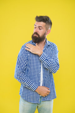 Shake it off. Summer hipster. Brutal bearded hipster in checkered shirt brush dust off shoulder. Male fashion. Pedantic man with beard on yellow backdrop. Mature man. Everything must be perfect